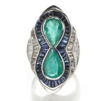 An emerald, sapphire and diamond ring