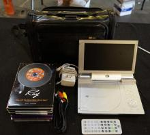 Portable DVD Player With Case And 8 Misc DVDs
