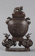 A BRONZE DECORATED LIDDED VESSEL