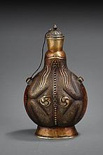 AN UNUSUAL CARVED BRONZE BOTTLE
