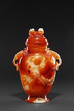 A CARVED RED AGATE TWO-HANDLED VASE