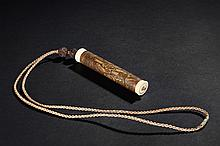 A CARVED BAMBOO INCENSE TUBE