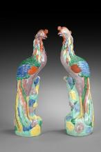 A PAIR OF FAMILLE ROSE FIGURES OF PHOENIX