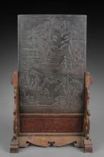 A CARVED HARDWOOD TABLE SCREEN INSET WITH DUAN STONE