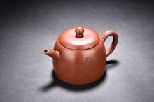 A YIXING RED CLAY 'INSCRIPTION' TEAPOT
