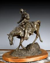 A CAST BRONZE COWBOY STATUE WITH THE TITLE 'THE RIDE FOR LIFE'
