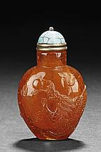 A CARVED AMBER