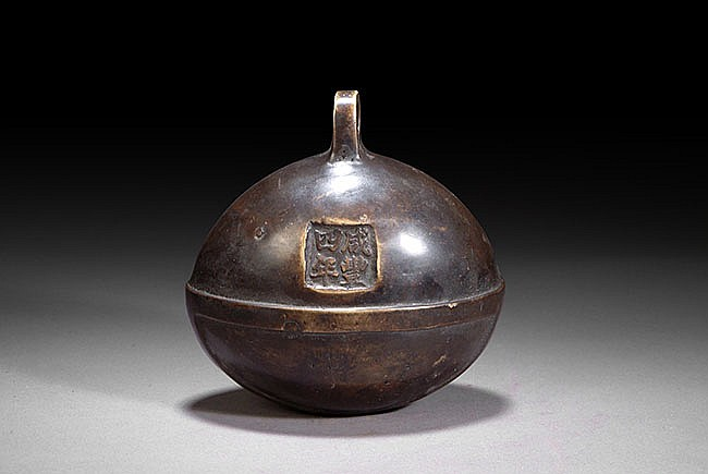 A CHINESE BRONZE SHELL BELL