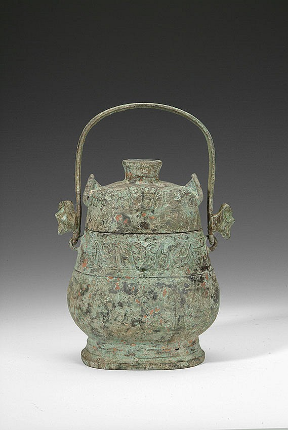 A CHINESE ANCIENT BRONZE LIDDED JAR