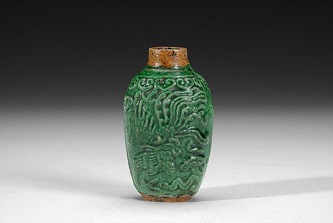 A CHINESE GLAZED SNUFF BOTTLE