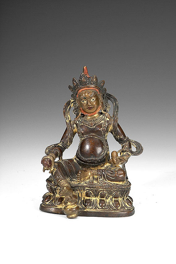 A TIBETAN GILT BRONZE FIGURE