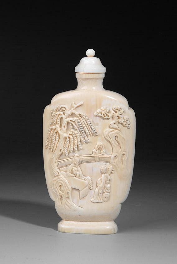 A WELL CARVED IVORY SNUFF BOTTLE