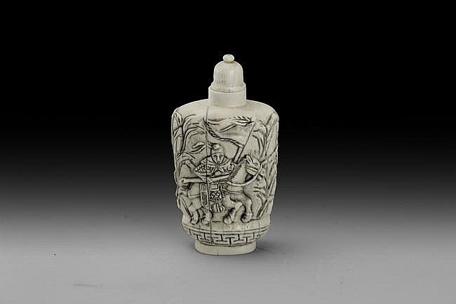 A WELL CARVED IVORY CARVED SNUFF BOTTLE