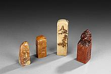 A SET OF FOUR SOAPSTONE SEALS