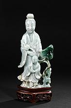 A CARVED JADEITE GUANYIN WITH CHILD FIGURE