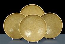 Quattro piatti in porcellana celadon, Cina XIX secolo