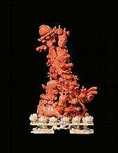 A coral figure of Guanyin on ivory base, China,