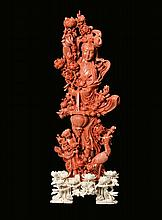 A carved red coral figure of Guanyin and other