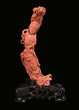 A coral figure of Guanyin with basket of flowers,