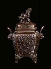 A bronze incense burner with stylized decoration,