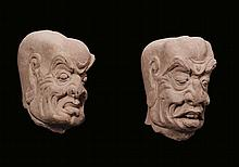 A pair of stone heads, China, probably Ming