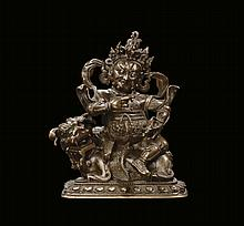 A bronze warrior on Pho dog, China, Qing Dynasty,