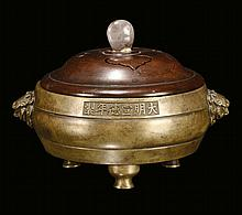 A bronze censer and cover with inscriptions,