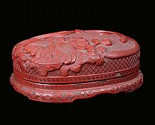 A red lacquer box with floral decoration, China,