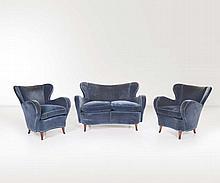 Salotto composto da coppia di poltrone e divano.