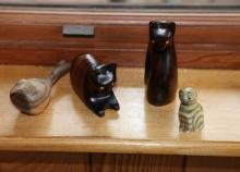 Four cat ornaments in wood and stone