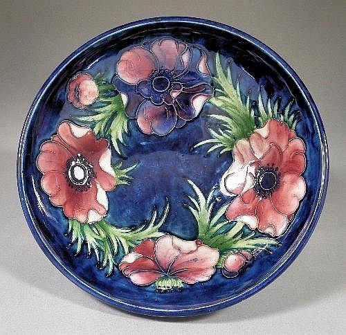 A Moorcroft pottery circular shallow bowl, tube
