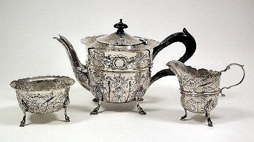 An Edward VII silver circular teapot with shaped