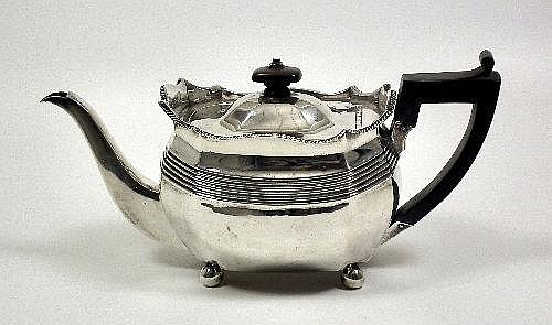 A George III silver teapot of octagonal panelled