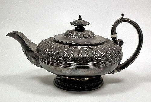 A George IV silver teapot with squat part