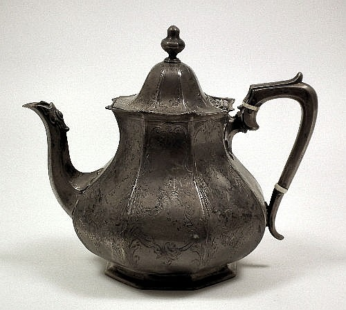 A Victorian silver teapot, the octagonal baluster
