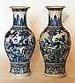 A pair of Chinese porcelain blue and white baluster shaped vases, finely decorated with birds in a flowering tree within deep leaf and key pattern borders, 17.25ins high (one with repair to rim, one with firing crack approximately 1.5ins to face)