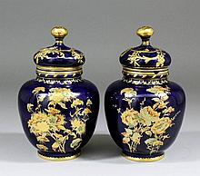 A pair of late 19th Century Royal Crown Derby bone china vases and covers p