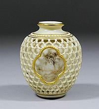 An early 20th Century Royal Worcester porcelain reticulated vase of baluste