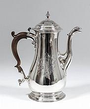 A George III plain silver baluster shaped coffee pot, the moulded and domed