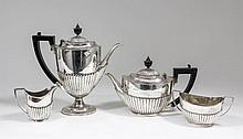 An Edward VII and George V silver Harlequin four piece tea and coffee servi