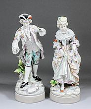 A pair of late 19th/early 20th Century Continental porcelain figures of a g