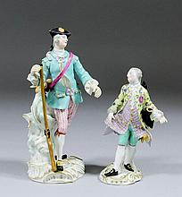 A 19th Century Meissen porcelain figure of a huntsman, 7ins high, and a fig
