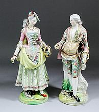 A pair of 19th Century Continental porcelain candelabra figures of a gentle