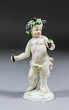 A 19th Century Meissen porcelain figure of a putto emblematic of