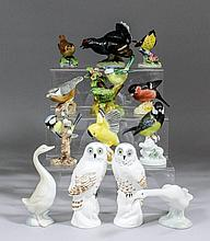 A collection of English and Continental ceramic bird models, including - Cr