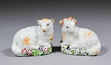 A pair of late 18th Century Derby porcelain figures of a recumbent ram and