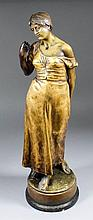 A late 19th/early 20th Century Goldschieder gilt bronzed terracotta figure