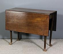 An 18th Century mahogany rectangular drop leaf cottage dining table, on tur