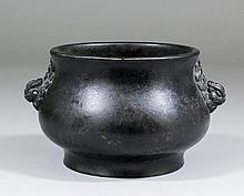 A Chinese dark patinated bronze circular two-handled censer of squat balust