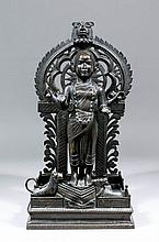 An Indian bronze standing figure of the deity